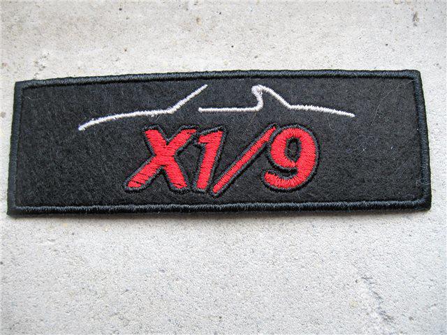 Afbeeldingen van borduurembleem X 1/9 silhouet